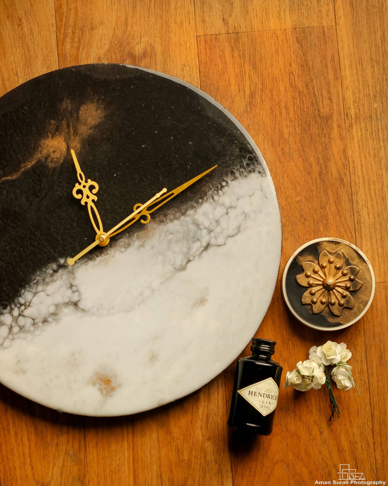 Picture of Black,Golden and White Resin Wall Clock